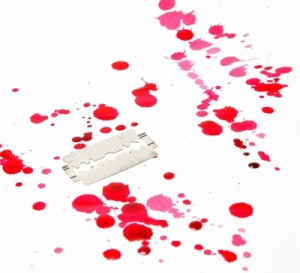 Razor Blade With Drop Of Blood Stock Photo courtesy of freedigitalphotosdotnet